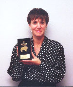 Judy Krawchuk, Marketing Manager of Willowbrook Shopping Centre, holding the prestigious MAXI Award