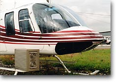 Picture of helicopter with aerial survey computer. Click to see larger Image