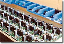 Picture of Work in Progress of 50 Power Supplies. Click to view larger image